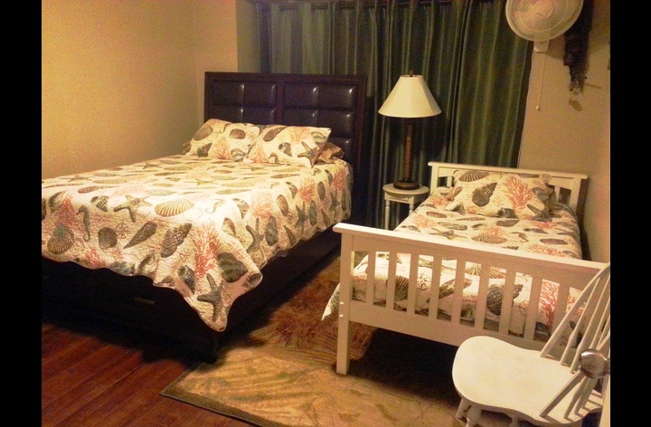 Second bedroom with queen and twin bed; with TV