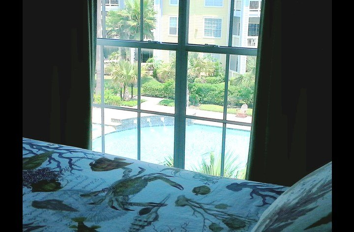 King bed with pool view