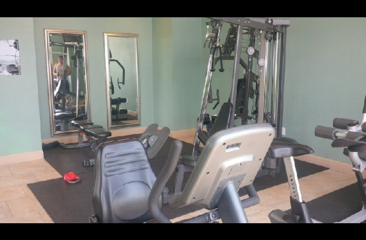 Equipment and free weights available at the fitness center