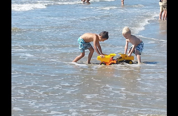 My little grandkids playing on the beach