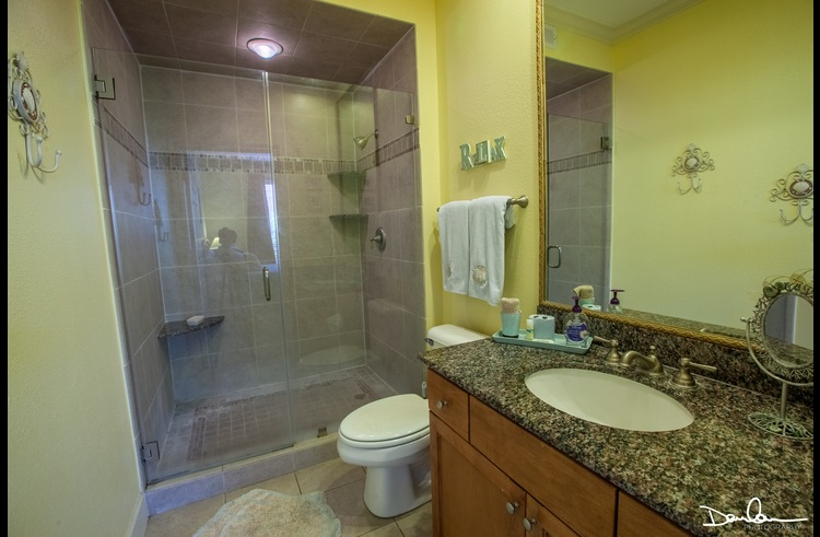 Full bathroom with walk in shower attached to master bedroom