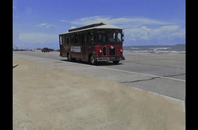 Galveston trolley stops and picks up outside the complex