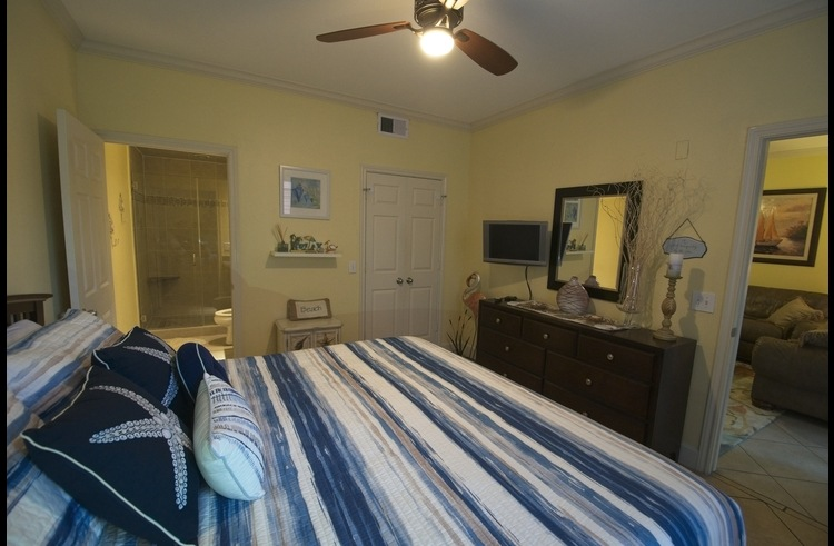 master bedroom with attached bathroom and King bed (TV)