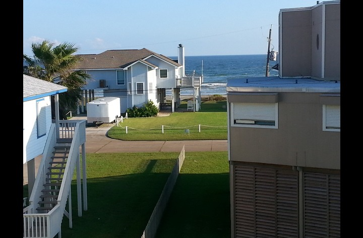 View of ocean and beach from top balcony