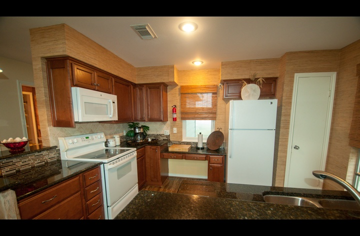 fully stocked kitchen with cooking utensils and full size appliances (dishwasher too)